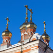 Stock Photo: Cupolas of Russiorthodox church against blue sky