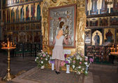 Young woman at the Iversky monastery in Valday, Russia — Stock Photo