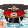 Russipolice officer cap on batch of banknotes — Stock Photo #19930833