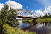 Steel Arch Bridge on river Msta. Novgorod region, Russia. — Stock Photo