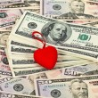 Red stylized heart on the money background — Stock Photo