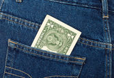 One U.S. dollar in the back jeans pocket — Stock Photo