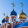 Cupolas of Russian orthodox church against blue sky — Stock Photo #22187555
