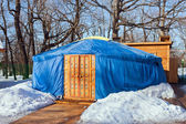 One blue yurt with big closed decorated orange door in the wint — Stock Photo