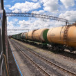 Freight train with petroleum tanker cars — Stock Photo #22381035