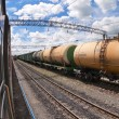 Freight train with petroleum tanker cars - Stock Photo