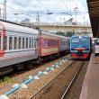 View of the railway track and  passenger trains in Russia - Stock Photo