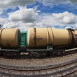 Freight train with petroleum tanker cars — Stock Photo #22381057