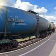 Freight train with petroleum tanker cars — Stock Photo #22381077