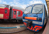 View of the railway track and passenger trains in Russia — Stock Photo