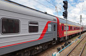 View of the railway track and passenger train in Russia — Stock Photo