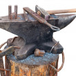 Stock Photo: Old anvil with blacksmith tools on outdoors