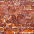 Old weathered red brick wall as background — Stock Photo