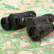 Russian army field binocular on the map — Stock Photo