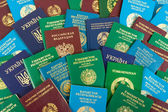 Different foreign passports as background — Stock Photo