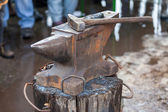 Old anvil with blacksmith tools on the outdoors — Stock Photo