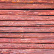 Red wood texture with natural patterns — Stock Photo
