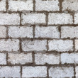 Old weathered white brick wall as background — Stock Photo