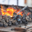 Forge fire in blacksmith's where iron tools are crafted — Stock Photo