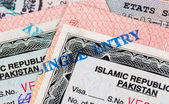 Pakistani Visa entry and exit stamps in passport — Stock Photo