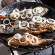 Fried fish in a frying pan — Stock Photo