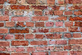 Viejo resistido pared de ladrillo rojo de grunge como telón de fondo — Foto de Stock