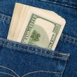 Stack of hundred dollar bills in the back jeans pocket — Stock Photo #31634435