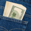 Stack of hundred dollar bills in the back jeans pocket — Stock Photo