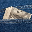 Stack of hundred dollar bills in the back jeans pocket — Stock Photo #31634457