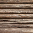 Wooden logs wall of old rural house background — Stock Photo