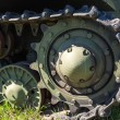 Stock Photo: Caterpillars of military tank close up detail