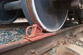 Train wheel and a brake shoe — Stock Photo