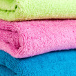 Stack of multicolored towels — Stock Photo #34640533