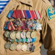 Numerous military awards and medals on the uniform of veteran sp — Stock Photo
