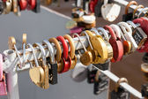 Padlocks, symbols of love hanging on the railing of the bridge — Stock Photo