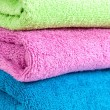 Stack of the multicolored towels — Stock Photo