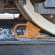 Freight car is secured with brake shoe — Stock Photo #39032903