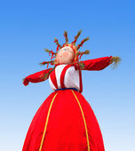 Shrovetide in Russia. Big doll for the burning on blue sky backg — Stock Photo
