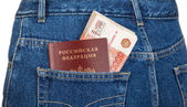 Russian rouble bills and passport in the back jeans pocket — Stock Photo