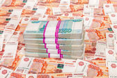 Pile of russian rubles bills on the money background — Stock Photo