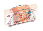 Napkin holder with pile of russian roubles bills — Stock Photo
