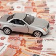 Toy car on the background of russian banknotes — Stock Photo