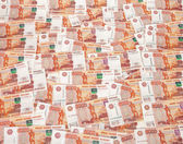 Heap of five thousand russian rubles banknotes as background — Stockfoto