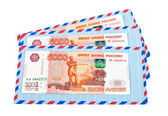 Envelopes and cash in russian rubles isolated on white backgroun — Stock Photo