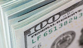 Heap of one hundred dollar bills close up — Foto Stock