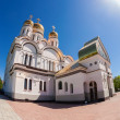 Russian orthodox church with gold domes against bright sunlight — Stock Photo #46897351