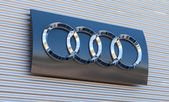 The emblem Audi on the office of official dealer — Stock Photo