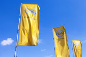 SAMARA, RUSSIA - MAY 25, 2014: The flags of Opel over blue sky.  — Stock Photo