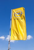 The flag of Opel over blue sky — Stock Photo