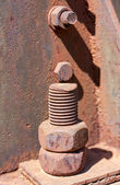 Old rusty bolt closeup and nuts — Stock Photo
